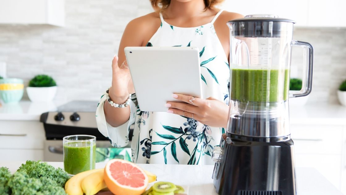 women reviewing tablet with meal plan