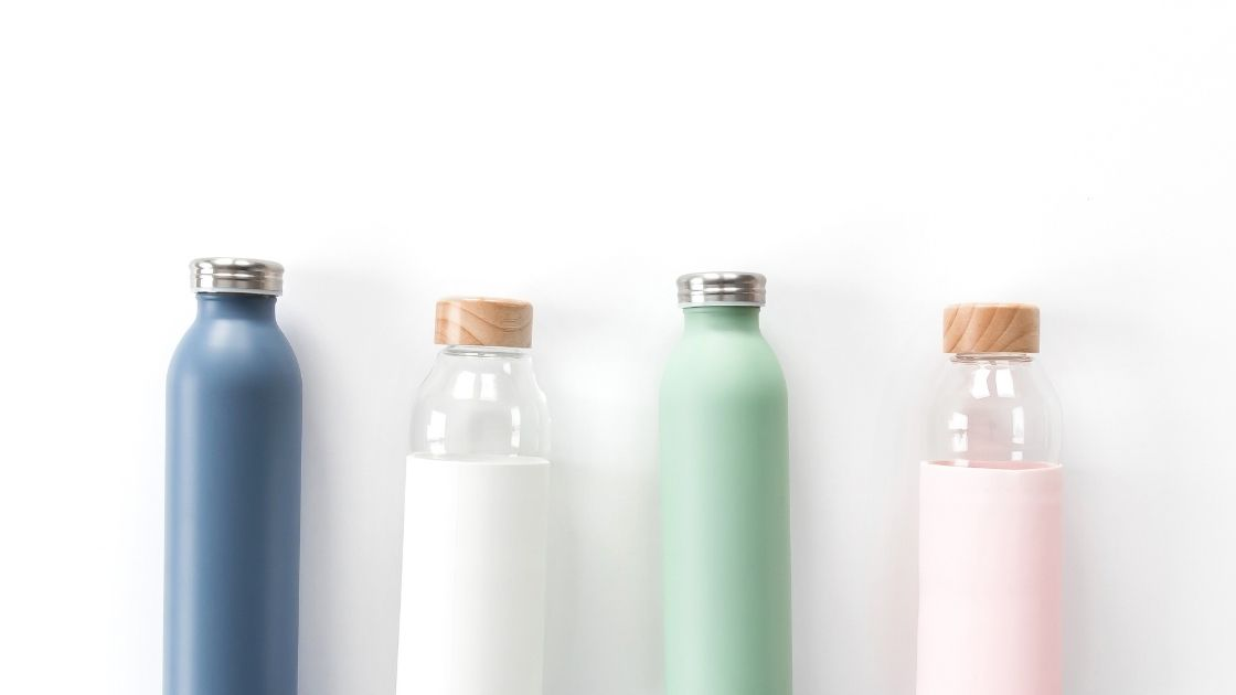 A collection of four water bottles on a white background