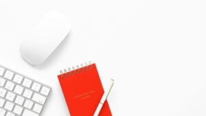 a notepad and pen on a white background
