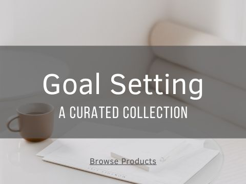 goal setting text on image of notepad and calendar on table.