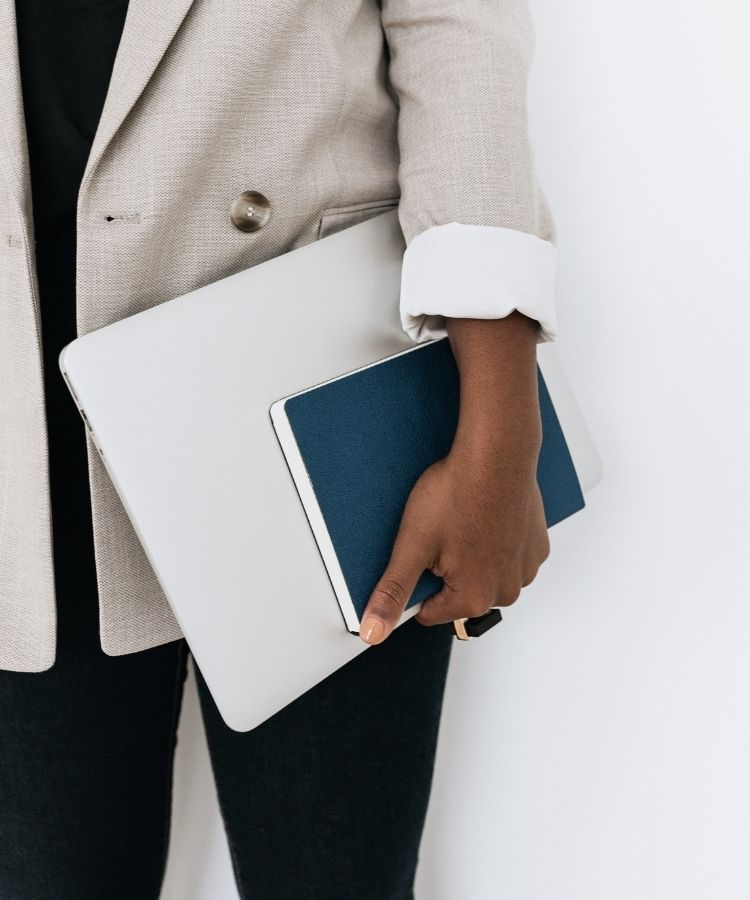 dietetic student holding navy notebook and notebook