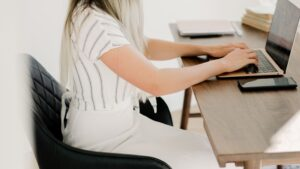 dietitian reading on tablet while sitting in chair